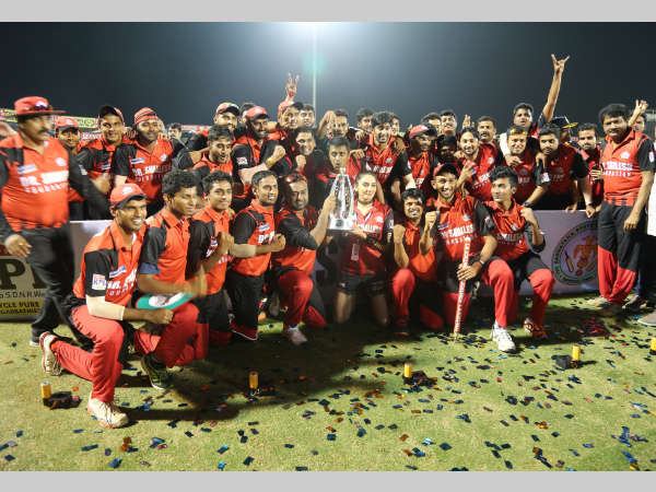 Bellary Tuskers' playes, owners and coaching staff celebrate after winning KPL 2016
