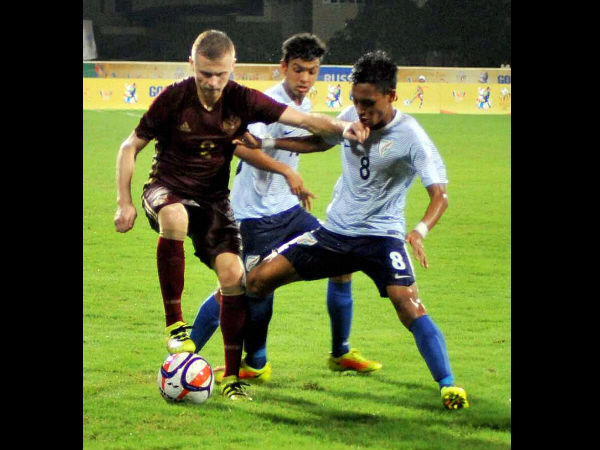 Russian and Indian players in action during their match at the 1st BRICS U17 Football Tournament at Bambolim in Goa