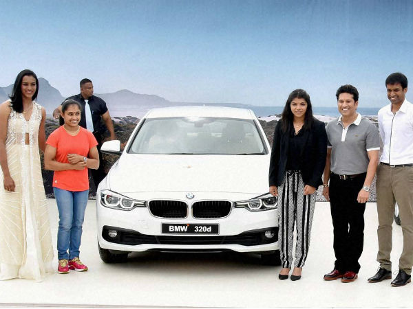 Dipa (2nd left) poses with her BMW car along with Sindhu (left), Sakshi Malik (3rd right), Sachin Tendulkar (2nd right) and Pullela Gopichand