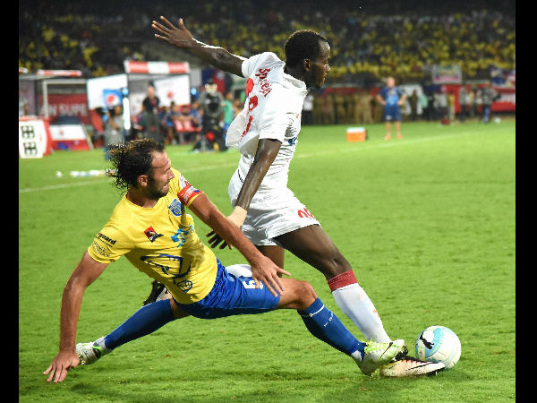 Players of Kerala Blasters FC ( Yellow Jersey) and Delhi Dynamos FC in action during the match of the 3rd season of Indian Super League ( ISL) 2016 in Kochi on Sunday.