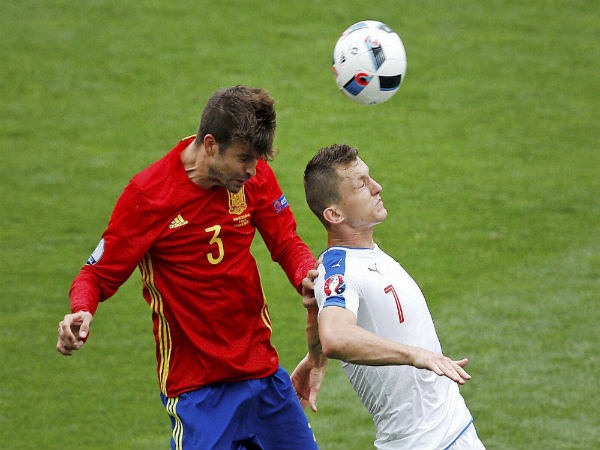Gerard Pique (left) in action for Spain