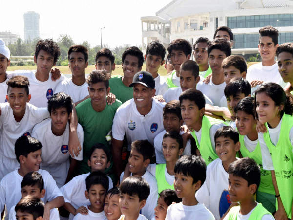 Rivaldo with school kids at a school in Greater Noida