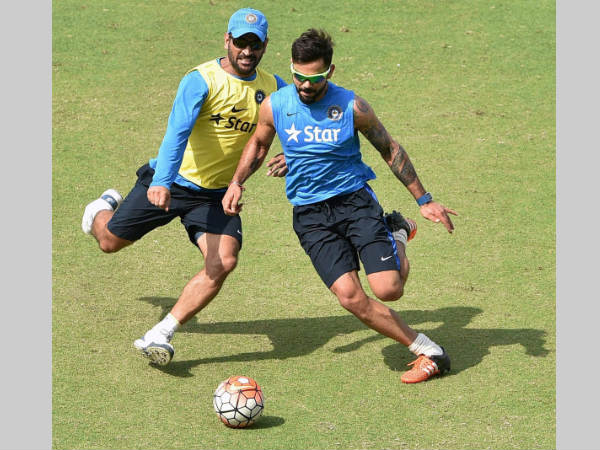 File photo: Dhoni (left) and Kohli during a game of football as part of team's practice