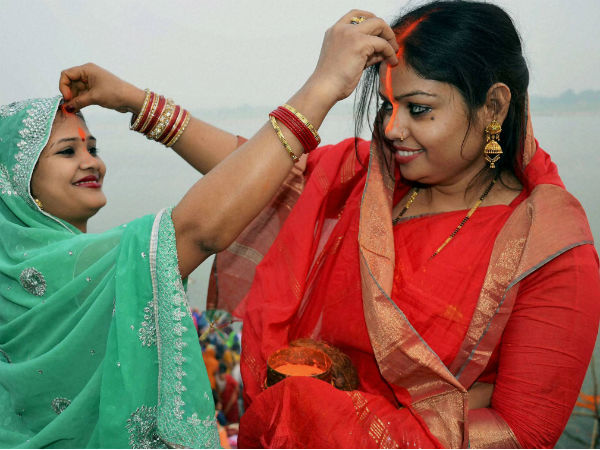 Woman devotees put vermillion on eachothers' forehead