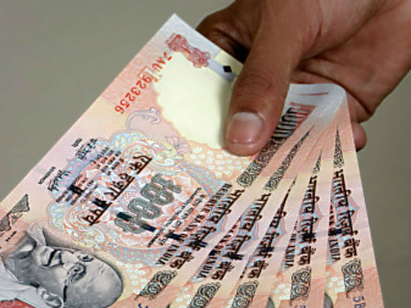 Old notes: Bank officials among 3 held