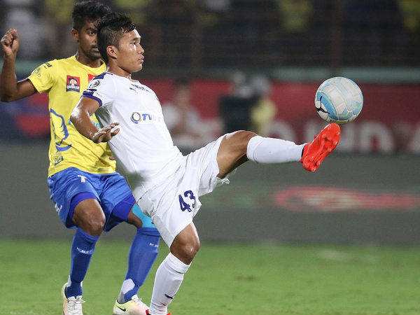 Kerala Blasters and Chennaiyin FC players fight for the ball