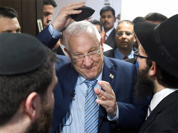 Rivlin pays tributes to victims at Chabad House