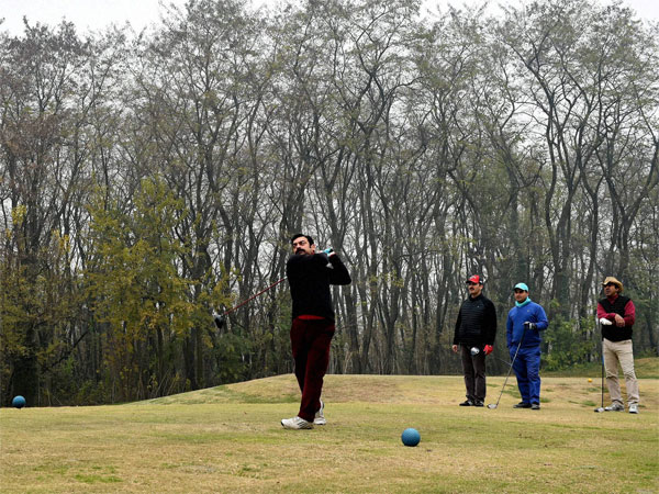 Golfers seen 'put'ting at Royal Spring Golf course