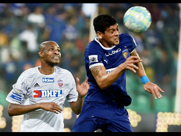 Players of Chennaiyin FC (in blue jersey) and Pune City (in white jersey) vie for the ball during their Indian Super League (ISL) match at Jawaharlal Nehru Stadium in Chennai.