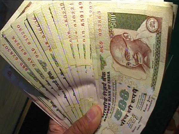 Burnt currency notes found in UP town