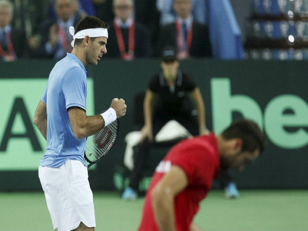 Argentina's Juan Martin Del Potro reacts after winning a point against Croatia's Marin Cilic