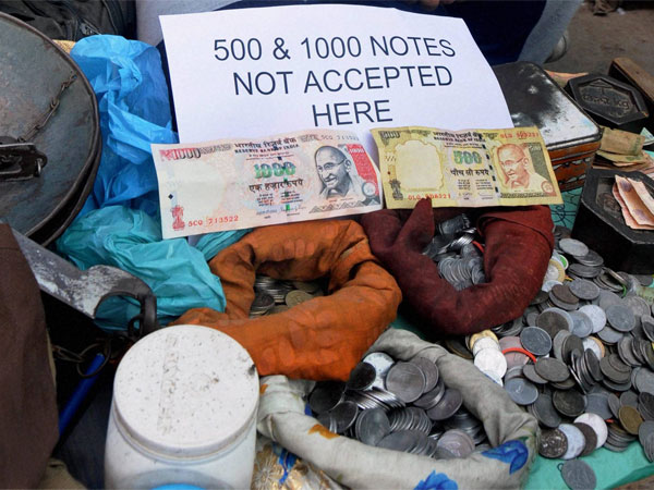 Allow use of old notes till Dec 31, strike on black money