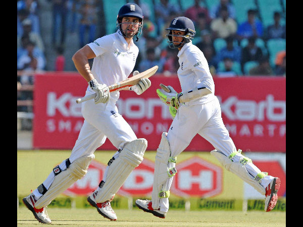 Hameed (right) runs between the wickets with his opening partner and captain Alastair Cook during the Rajkot Test