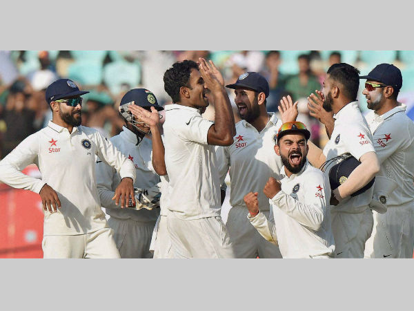 Jayant Yadav (3rd left) celebrates with team-mates his maiden wicket, having dismissing Moeen Ali