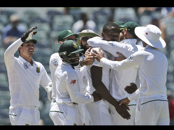 South Africa's Kagiso Rabada, 3rd right, celebrates with his team after he took the wicket of Australia's Mitchell Starc on the fifth day of play during their cricket test match against Australia in Perth, Australia, Monday.
