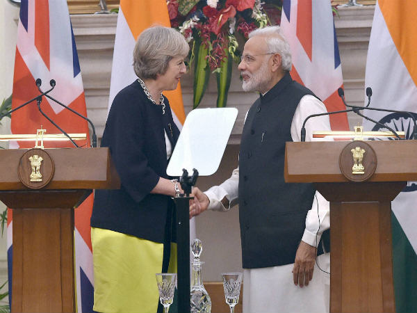 Prime Minister Narendra Modi (right) and UK Prime Minister Theresa May shake hands during the joint statement at Hyderabad House in New Delhi
