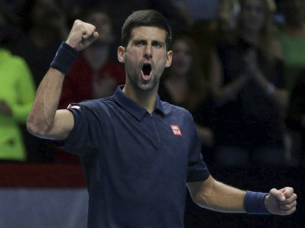 Serbia's Novak Djokovic celebrates winning his ATP World Tour Finals tennis match against Austria's Dominic Thiem at the O2 Arena in London.