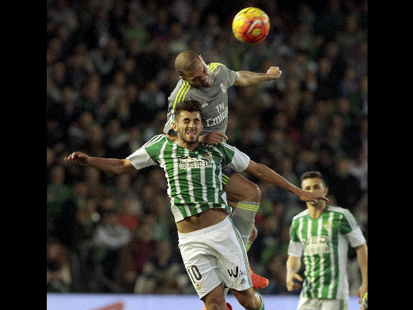 Real Madrid's Pepe, top, and Betis' Dani Ceballos, button, fight for the ball during their La Liga soccer match at the Benito Villamarin stadium, in Seville, Spain