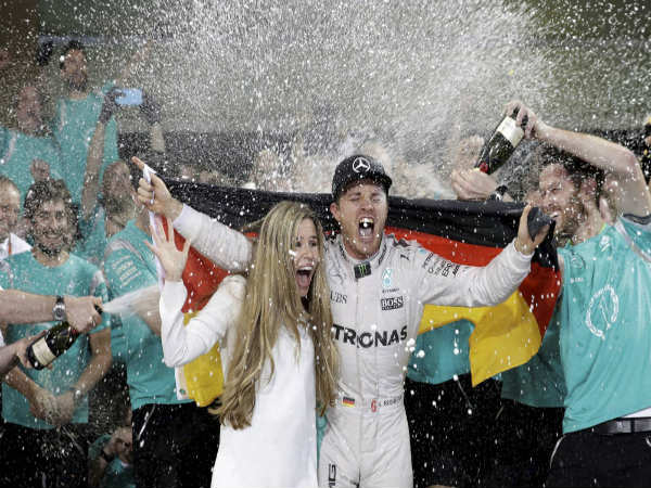 Nico Rosberg (right) celebrates after winning the F1 title