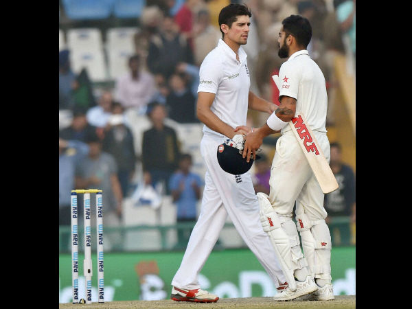 Virat Kohli greets England captain Alastair Cook after India won the third Test match against England in Mohali on Tuesday.
