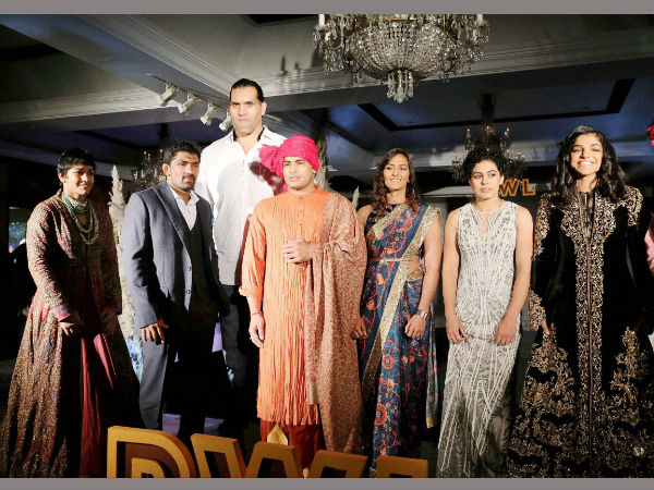 Indian wrestlers walk the ramp with The Great Khali