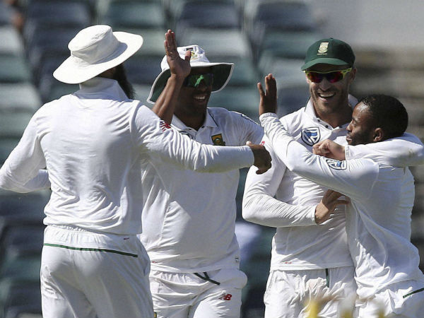 South Africa's captain Faf du Plessis, second from right, celebrates with teammate Temba Bavuma.