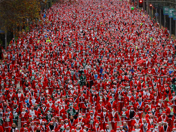 Santas participate in a race in Madrid