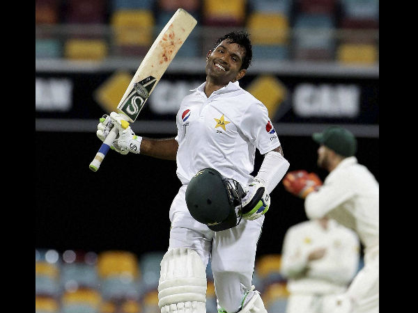 Pakistan's Asad Shafiq reaches 100 runs during play on day four of the first cricket test between Australia and Pakistan in Brisbane, Australia, Sunday, Dec. 18