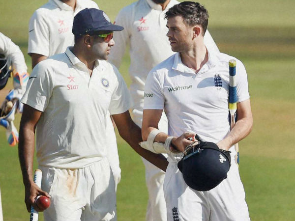 Ashwin (left) talks to Anderson as they walk off the ground after the 4th Test in Mumbai