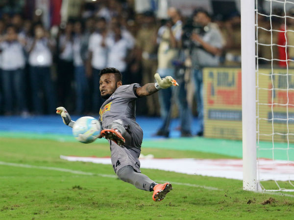 Atletico de Kolkata goalkeeper Debjit Majumder saves a crucial shot during penalty shootout against Kerala Blasters FC in Kochi