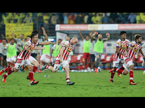 Atletico de Kolkata players celebrate after winning the title of Hero Indian Super League season 3 against Kerala Blasters FC in Kochi