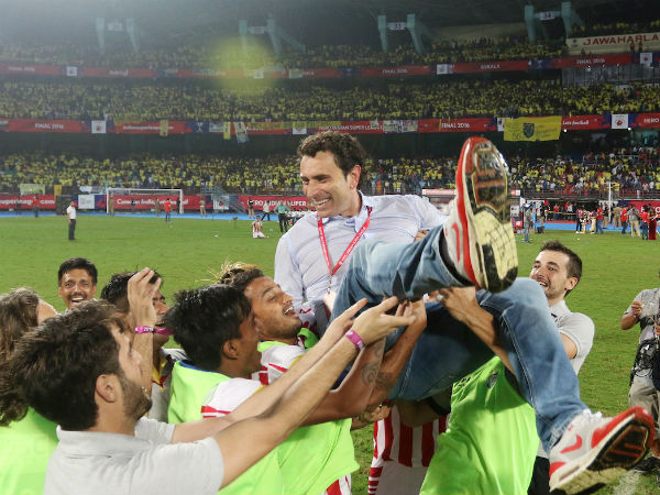 Atletico de Kolkata players celebrate their victory against Kerala Blasters FC with coach Jose Molina