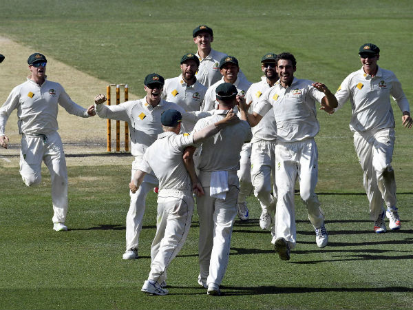 Australian players celebrate defeating Pakistan by more than an innings on the fifth day of their second cricket test in Melbourne