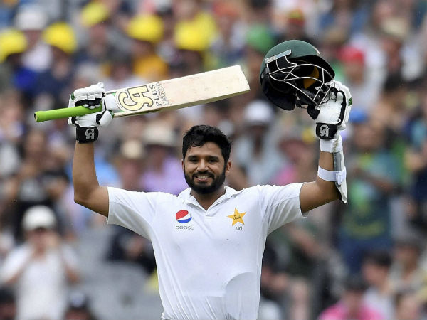 Pakistan's Azhar Ali celebrates scoring a century against Australia on the second day of their second cricket test match in Melbourne, Australia