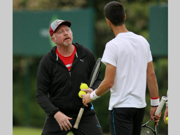 File photo: Becker talking to Djokovic (right)