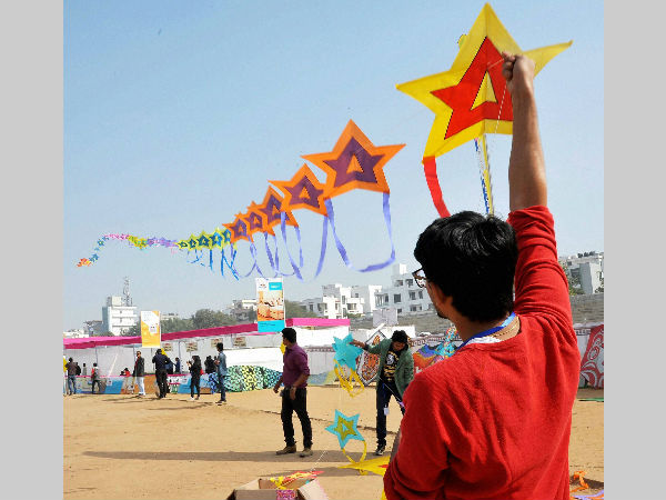 File photo: People enjoy kite flying at Chitrakot Stadium during the International kite festival on the occasion of 'Makara Sankranti' in Jaipur on January 13, 2015.