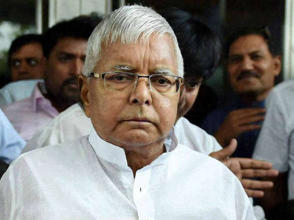 Row erupts over reports about presence of Lalu aides in jail to 'serve' him
