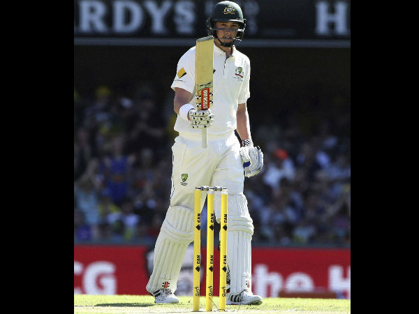 Australian batsman Matt Renshaw signals to the crowd after reaching a half century during play on day one of the first cricket test between Australia and Pakistan in Brisbane, Australia
