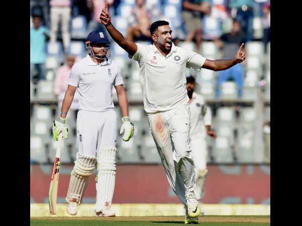 Indian spinner R Ashwin celebrates the wicket of England batsman Keaton Jennings on the first day of the fourth Test match against India in Mumbai.