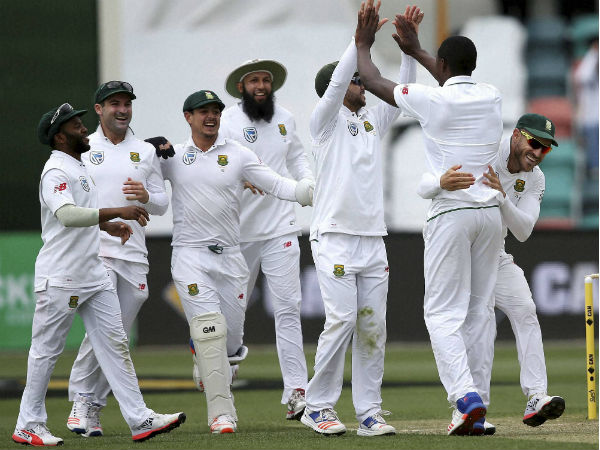 South African teammates celebrate with South Africa's Kagiso Rabada
