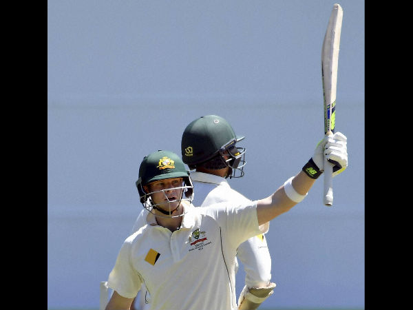 Australian captain Steven Smith raises his bat after scoring 150 runs against Pakistan on the fifth day of their second cricket test in Melbourne
