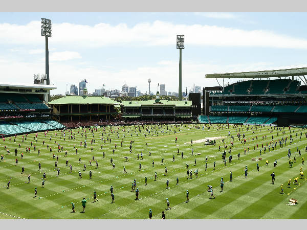 Young cricketers are seen on the SCG ground as they create Guinness World Records title
