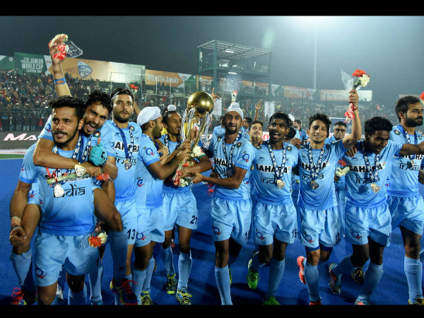 Indian Junior hockey players celebrate with the winning trophy after their victory over Belgium in the final Junior World Cup Hockey 2016 in Lucknow.