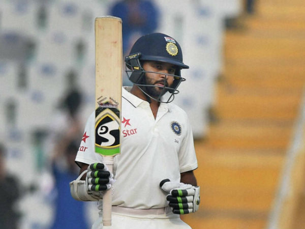 Parthiv Patel celebrates his half century in the 3rd Test against England in Mohali
