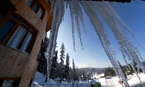 Crystalline icicles covered rooftop: