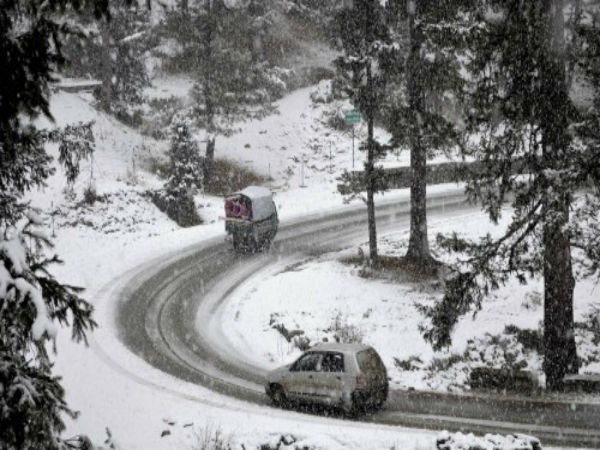 Vehicles plying on a snow-covered road