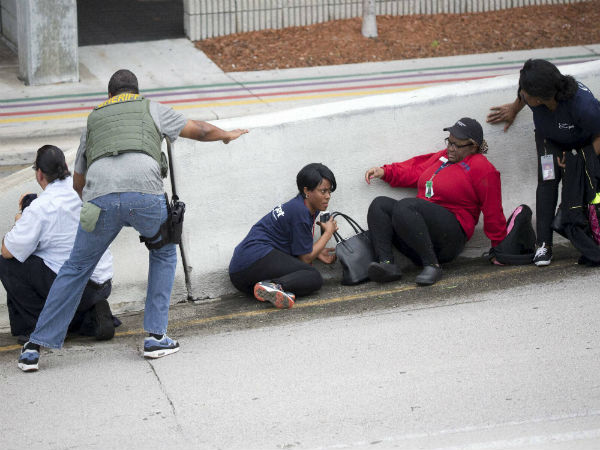 Bystanders lay low outside the airport