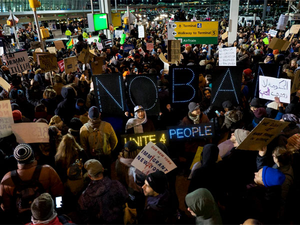 Protestors gather outside JFK airport