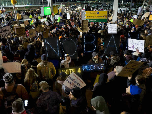 People protest against Donald Trump's ban
