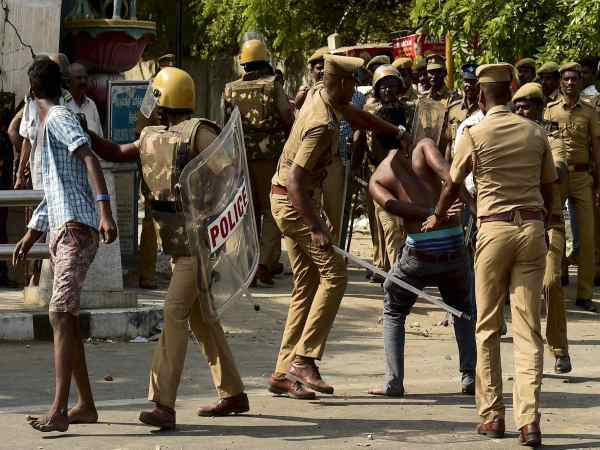Police lathicharge to disperse protesters during a violent clash with the police near Marina Beach in Chennai.